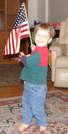Lil' Bro Holding Flag