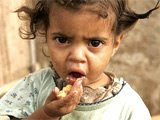 An AIDS orphan eats from a plate of food at a kindergarten in Manzini, Swaziland.