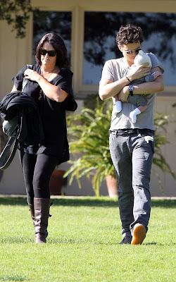 Orlando Bloom out with baby Flynn