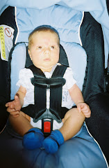 Maddox hanging out in his carseat.