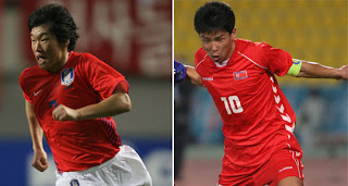 South Korea's Park Ji-sung and the north's Hong Yong-cho