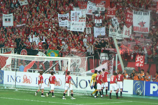 Urawa players celebratew with fans