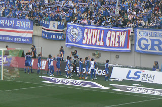 Suwon players celebrate with their fans