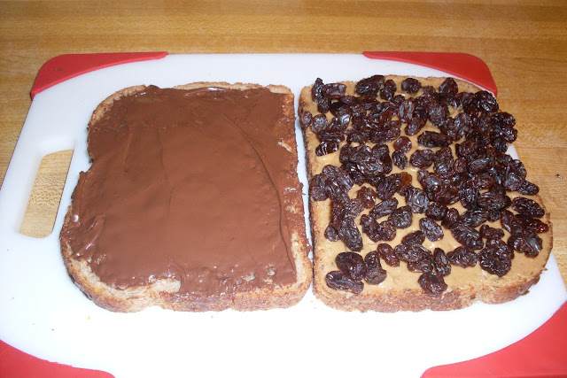 Tastes just Like a Candy Bar Sandwich, with peanut butter, nutella and raisins.