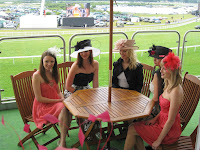 Models posing during a photo shoot at Royal Ascot