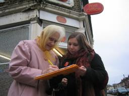 Save the post office, old lady and teenager sign petition to save the post offices. from http://www.brentlibdems.org.uk/images/sites/217.160.173.25-3e678870b1c3f9.89263653/52.jpeg