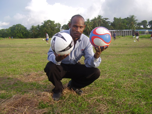 Club Treasurer Mr. John Keni displaying the two balls donated by Rubina (NZ)