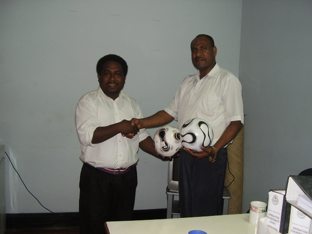 Mr. Nicholas Mirou (right) hands over 2 balls he donated to the Club to the President on 11/02/08