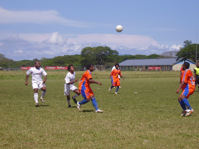 Santos' right defender Kennedy (left), Mike Suta (centre) and Guyllard (right) eyeing the ball