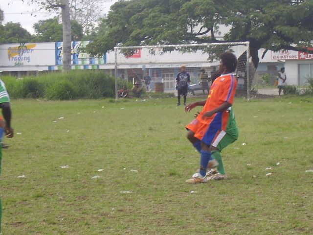 SANTOS MIDFIELDER MIKE SUTA TIGHTLY MARKED BY A DMP PLAYER