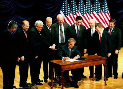 Bush signs anti-abortion law November 5, 2003. photo White House.