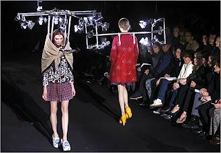 Viktor & Rolf fashion show Models wear lighting grids