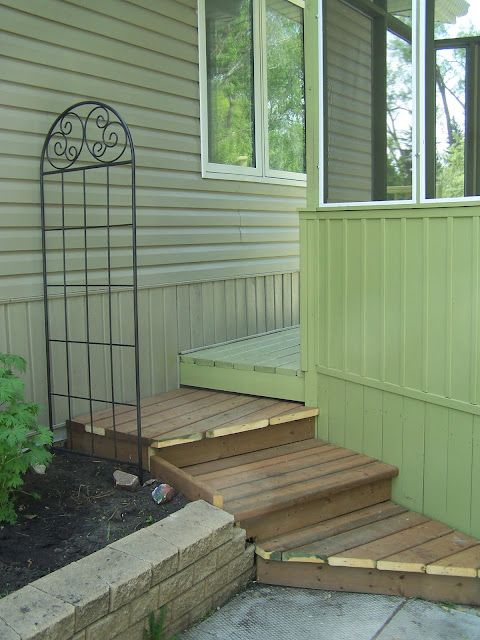 steps down from deck to patio behind gazebo