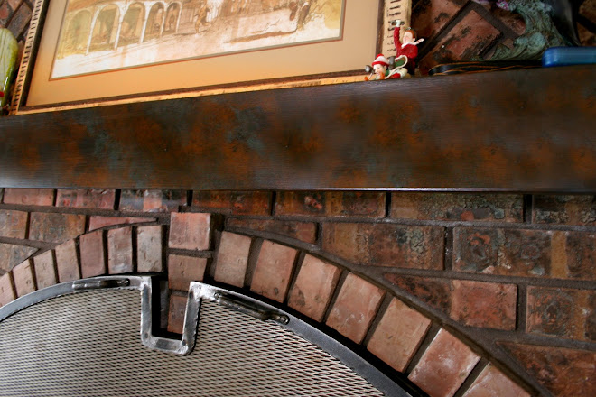 Fireplace mantle painted to match brick