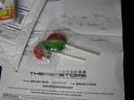 Handwritten note with lollipops