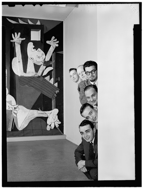 "Portrait of Ralph Burns, Edwin A. Finckel, George Handy, Neal Hefti, Johnny Richards, and Eddie Sauter, Museum of Modern Art, New York, N.Y., ca. Mar. 1947. Caption from Down Beat: Taking six arrangers of the modern school to the Museum of Art to pose with pieces by Picasso and Henry Moore seemed like a great idea to staff lensman Bill Gottlieb. Ralph Burns, Eddie Finckel, George Handy, Neal Hefti, Johnny Richards, and Eddie Sauter obliged, then the trouble started. For details, read the story by Gottlieb on page 2. Forms part of: William P. Gottlieb Collection (Library of Congress). In: ""Arrangers on the cover,"" Down Beat, v. 14, no. 7 (Mar. 26, 1947)."