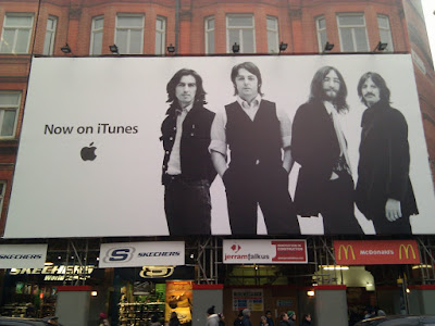 Beatles on iTunes poster on Oxford Street