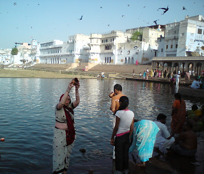 Offering water to the Sun God at the Pushkar Lake