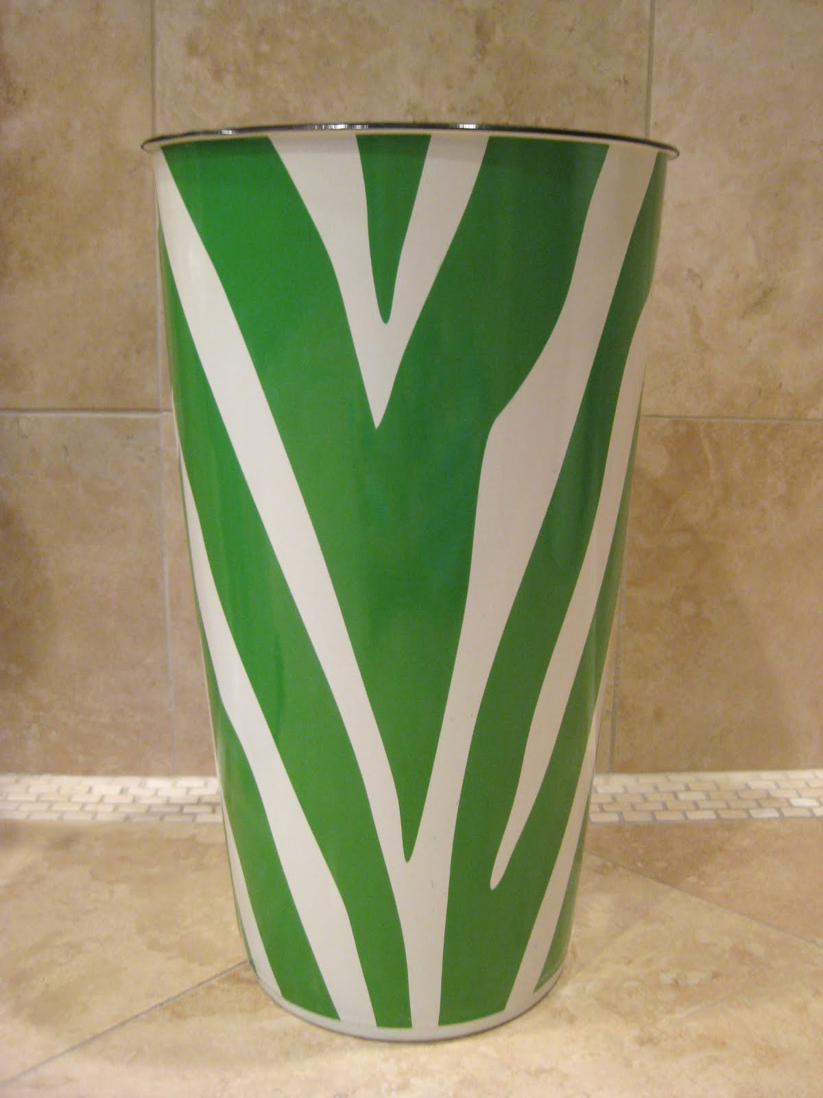 They are tall so trash settles to the bottom out of sight heres a fun kelly green zebra striped one