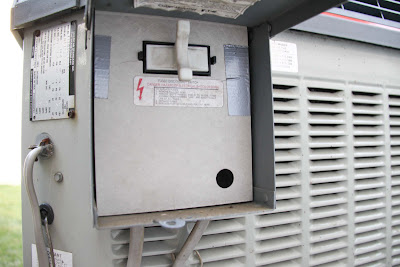 work space replacing fuse on central ac unit. Black Bedroom Furniture Sets. Home Design Ideas