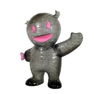 Smoke Grey Mummy Boy Vinyl Figure with Pink Grin by Super7
