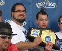 Dimitri Fetokakis, owner of Niko Niko's, awarding Patrick Bertoletti the Gyro Eating Championship Belt