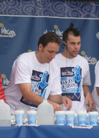 Joey Chestnut and Patrick Bertoletti preparing for the Niko Niko's World Gyro Eating Championship