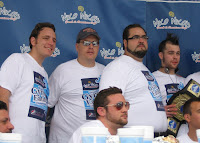Joey Chestnut, Bob Shoudt, Dimitri Fetokakis and Pat Bertoletti posing for pictures after the event