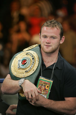 Wayne Rooney carries a belt for junior welterweight boxer Ricky Hatton