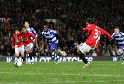 Manchester United's Carlos Tevez scores from the penalty spot