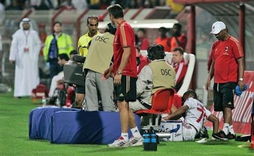 AC Milan forward Robinho receives medical care after he hit a TV camera