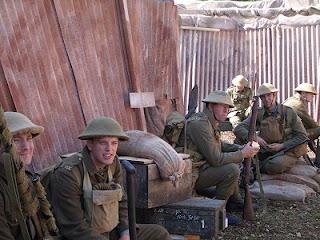 WWI British soldiers relax in their trench