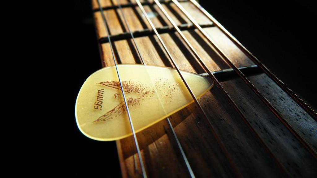 great guitar sound guitar wallpaper guitar strings and plectrum 1024x576. Black Bedroom Furniture Sets. Home Design Ideas