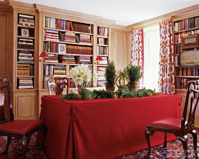 Miles Redd library with red skirted table chirstmas decor