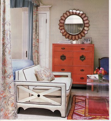 lucite table in a sitting area in a bedroom