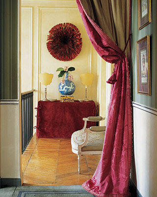 Rose Anne de Pampelonne Paris hallway with african hat on the wall via belle vivir blog