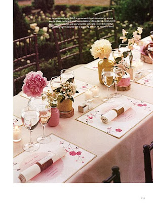 Who says that your table should be full of flowers A centerpiece of candles