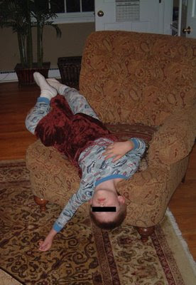 thing 2 sleeping upside down in chair