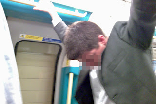 Drunk office worker on the Jubilee Line, falling asleep while standing up