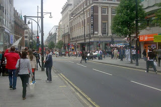 Crowded Oxford Street in Central London's West End on a busy Sunday morning