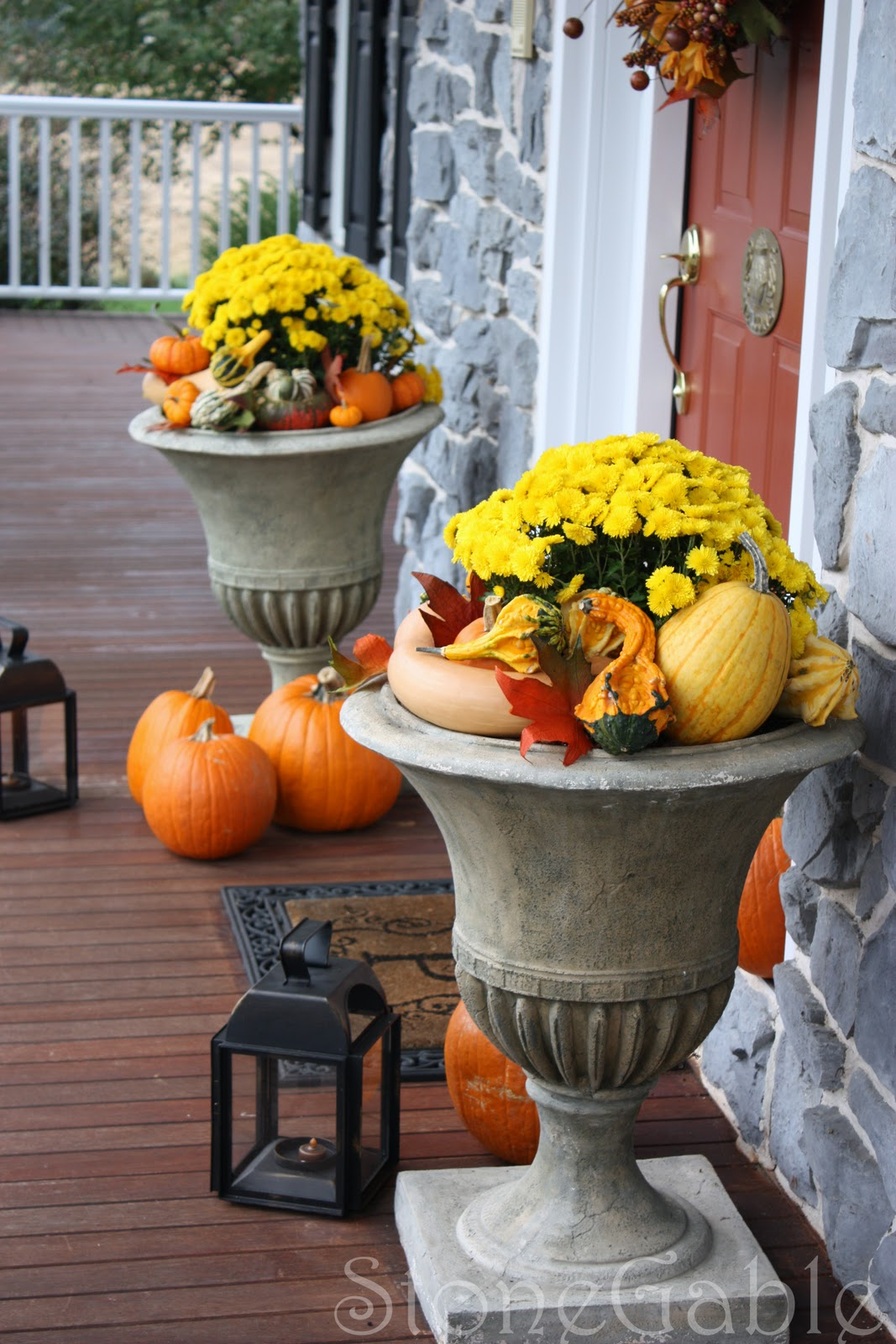Bright Yellow Mums Fill The Urns That Flank Front Door Pumpkin Gourds And Leaves In Around
