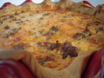 Southwestern Sausage Quiche - great for breakfast, lunch or dinner!! Can make ahead and freeze unbaked for later!! Sausage, cheddar cheese, diced tomatoes and green chiles, eggs, Ranch, sour cream, milk and pie crust. I always have to double the recipe! Gone in a flash!!