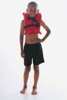 boy wearing PFD