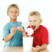 boys eating frozen treat