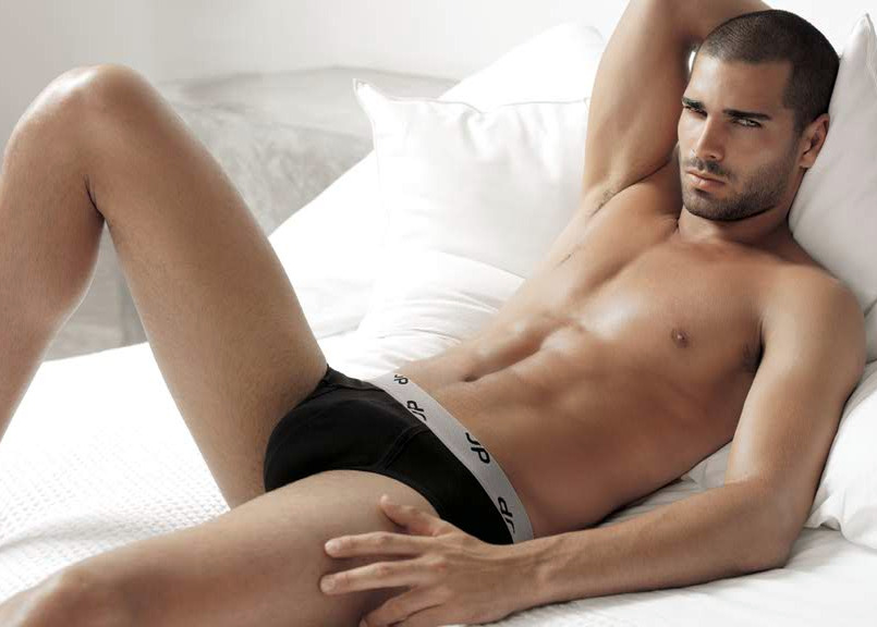 hot guy laying down