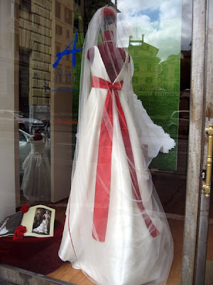 Wedding dress with red sash.