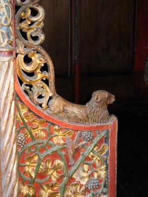 Carved armrest beast