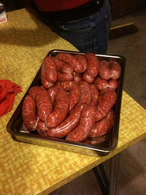 a tray of kobas sausage links