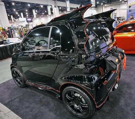 Maybe It Is Because Of The Economic Situation Or Perhaps A Parking Problem But Batmobile Smart Car Seems Like Great Financial Answer For Batman