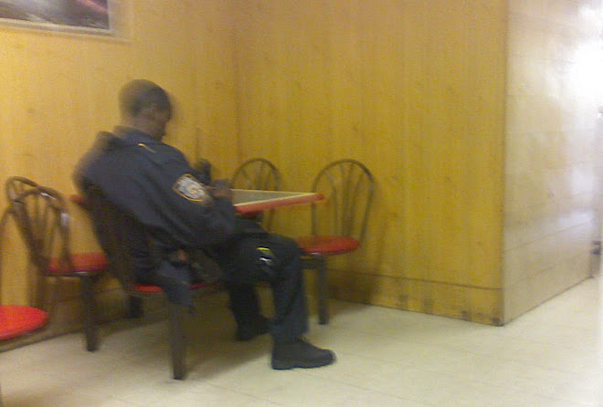 Officer Playing a PSP in a Brownsville pizzeria